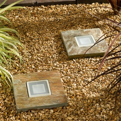 Diy landscape lighting home design ideas and inspiration for Solar powered glow stepping stones